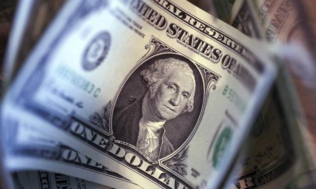 O dólar opera com viés de baixa na manhã desta segunda-feira, 16
