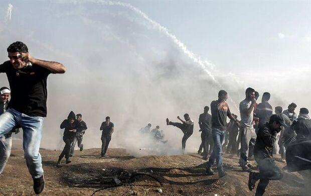 Confronto entre palestinos e tropas do Exército israelense na Faixa de Gaza/Mohammed Saber/Agência EFE/direitos reservados