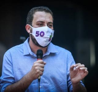 O candidato Guilherme Boulos (PSOL), durante encontro com empreendedores e pequenos comerciantes na quinta-feira, 26
