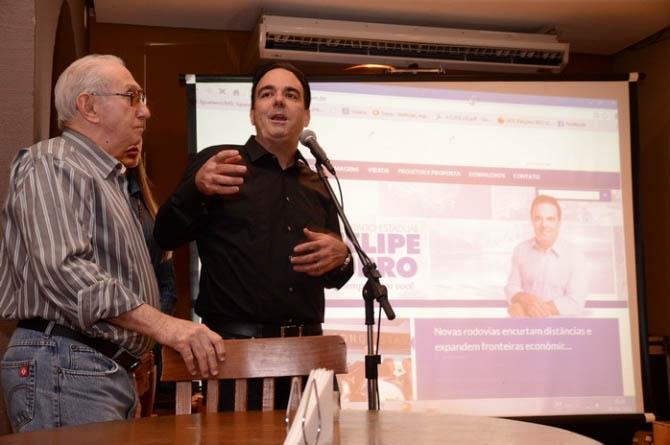 Roberto Orro e Felipe em foto durante evento do filho deputado em 2013