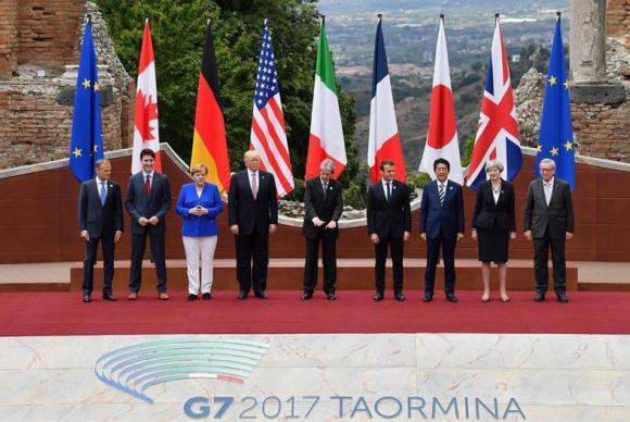 Donald Tusk; Justin Trudeau; Angela Merkel; Paolo Gentiloni; Emmanuel Macron; Shinzo Abe; Theresa May, Jean-Claude Juncker