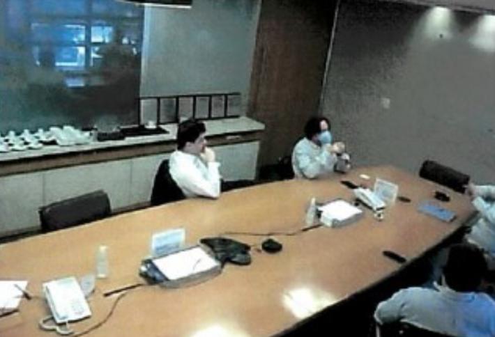 Reunião de pedido de propinas na qual se vê o Diretor de Secretaria Divannir (à esquerda) e o perito Tadeu (à direita)